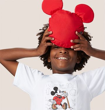 A young man in Columbia gear inspired by Mickey Mouse.