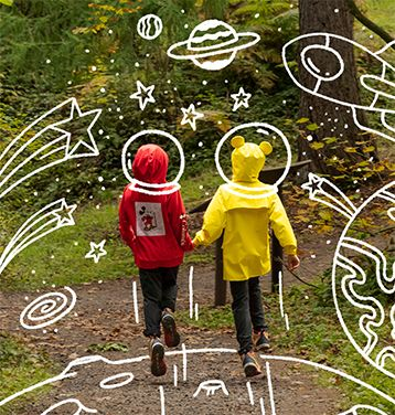 Two kids exploring the outdoors in gear inspired by Mickey Mouse.