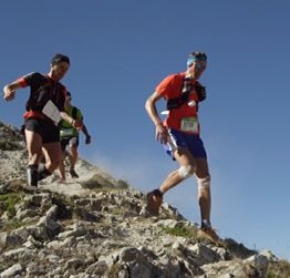 Still photo from the UTMB video Endure. Play button links to video.