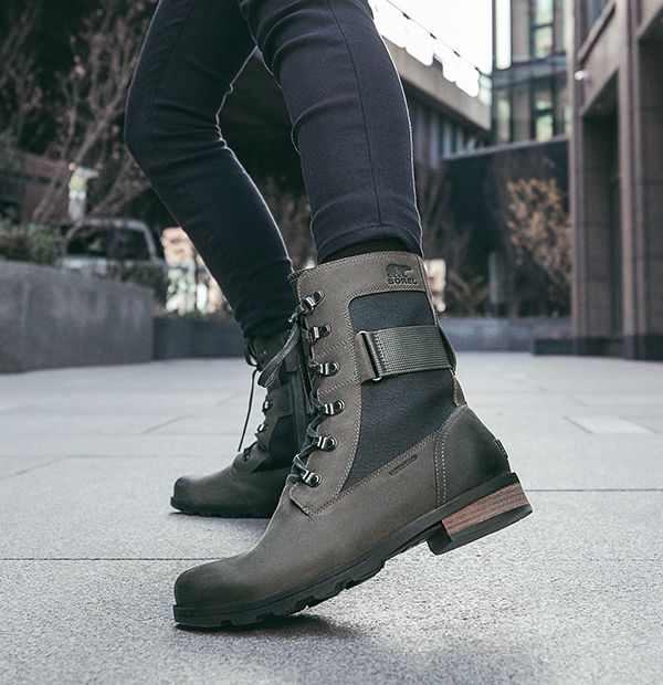 Close up image of woman's wearing Emelie Conquest boots in city