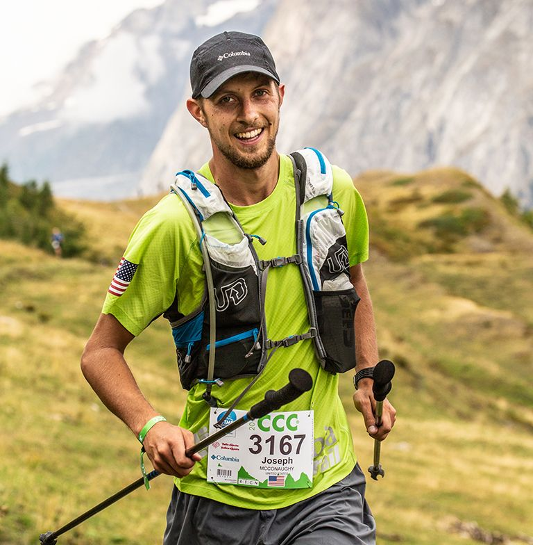 A man in Columbia gear running the UTMB.
