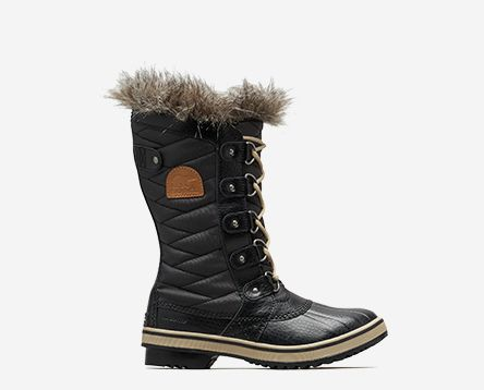 A black Tofino boot on a white background