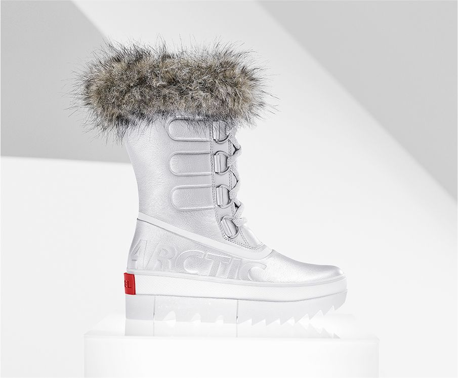 A profile view of a silver Joan NEXT boot on white background