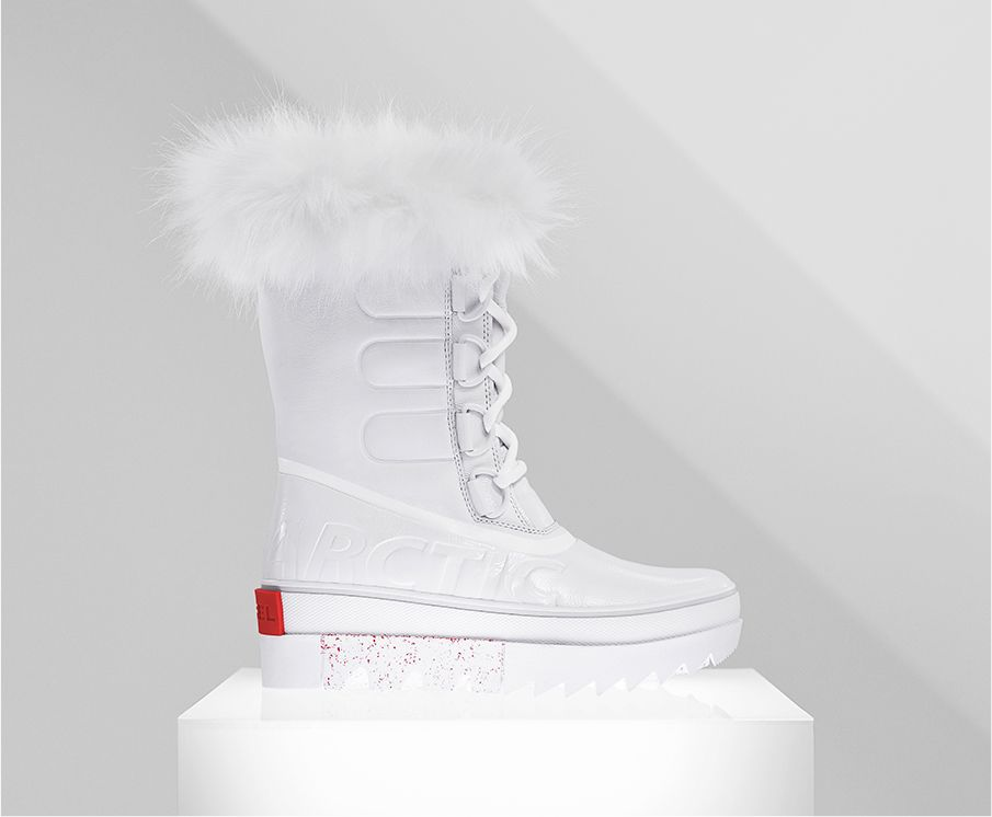 A profile view of a white Joan NEXT boot on white background