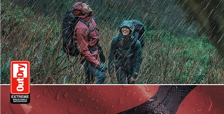 Hikers in the rain wearing Columbia OutDry Ex jackets.