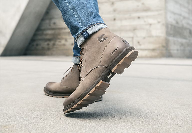 Man wearing Madson boots while walking through city