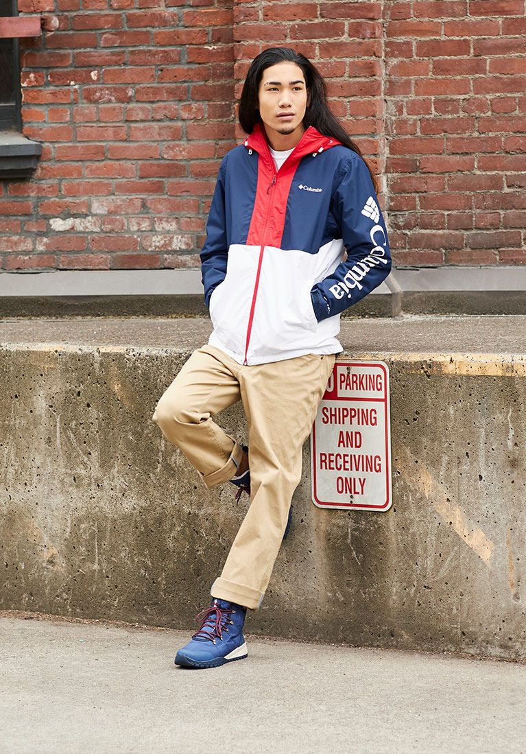 Head to toe look Man in blue, red, and white anorak, khakis, and blue sneaker boots.