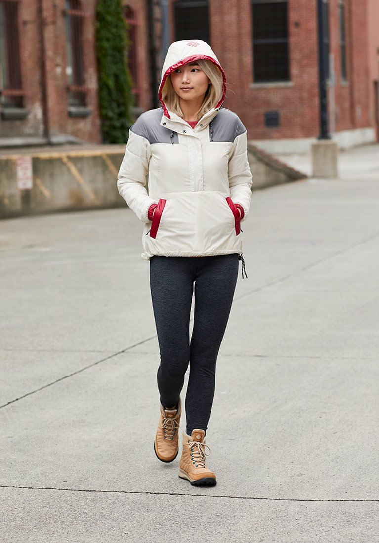 Head to toe women's look White colorblock anorak, black skinny pants, tan boots.