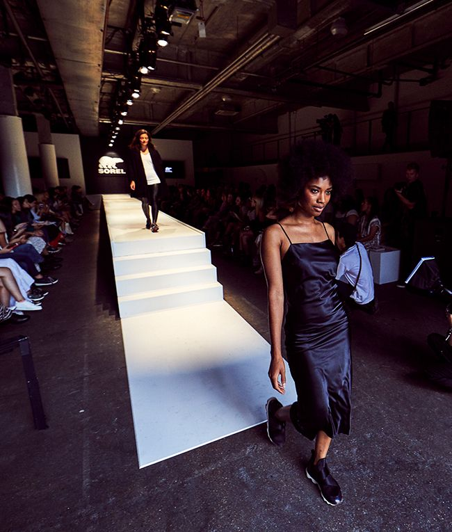 Women walking down the stairs of inside the SOREL Mile-Long Runway event