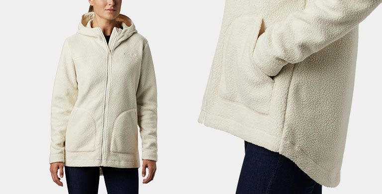 a woman in a fuzzy white sherpa jacket
