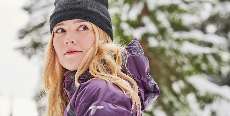 Close-up of a woman in a Columbia jacket and beanie.
