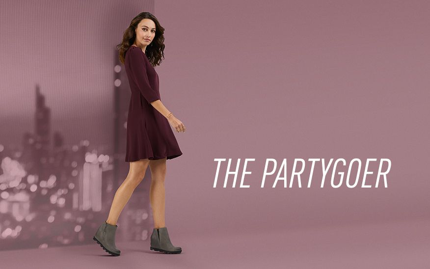 THE PARTYGOER, woman wearing dress and SOREL wedges on purple background