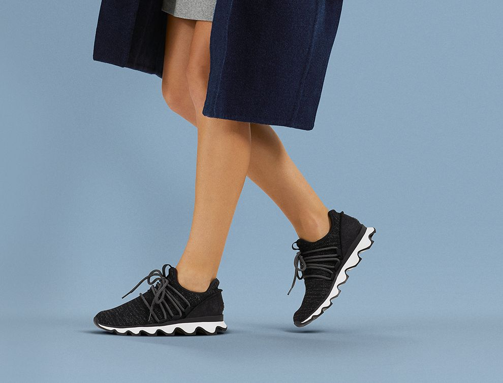 Shot of woman's legs wearing Kinetic Sneaks