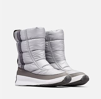 A pair of Out N About Puffy Mid boots on a white background