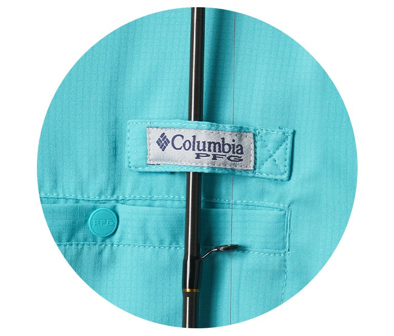 A close up of a rod holder and chest pocket on the Tamiami II shirt.