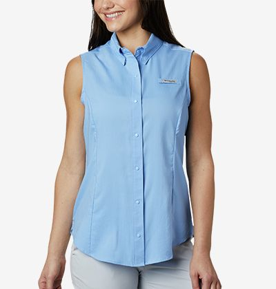 A woman in a sleeveless PFG shirt.