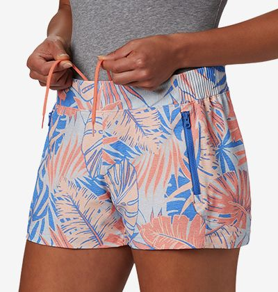 A woman in patterned PFG shorts.