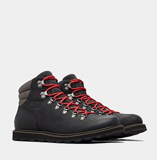 A pair of SOREL men's hiker boots now a white background