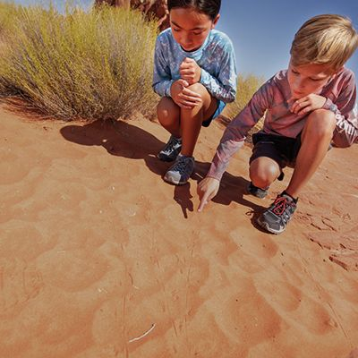 Two kids playing in the sand.