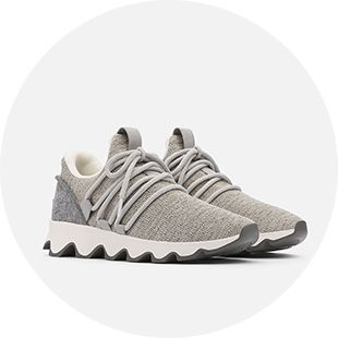 A pair of sneakers on a grey background