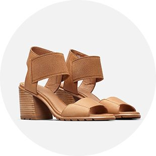 A pair of Nadia sandals on a grey background