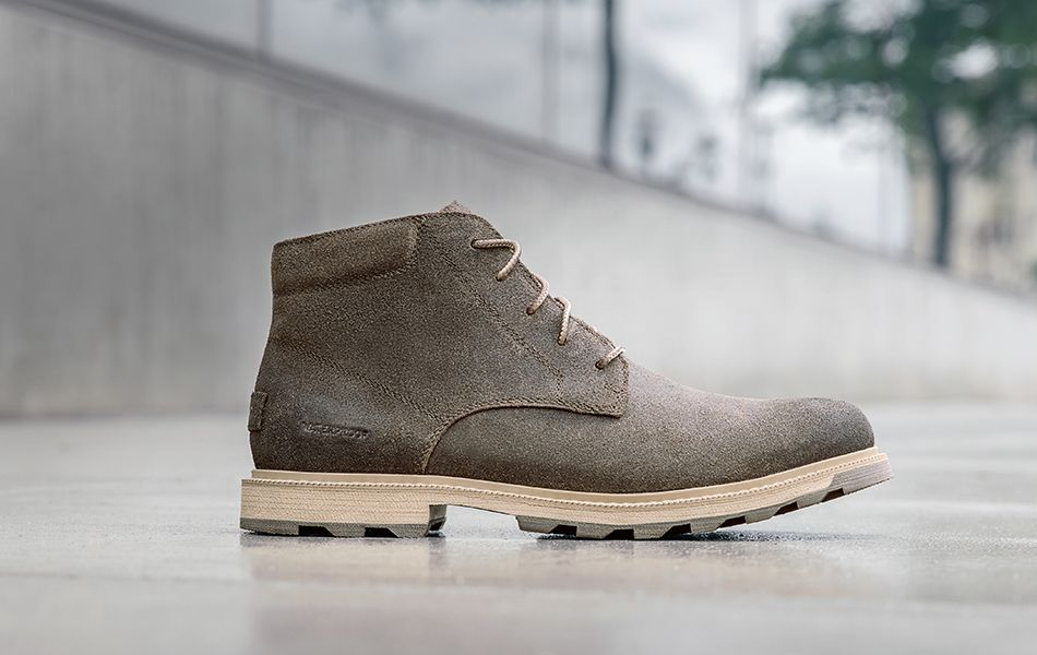A men's Madson boot on a city sidewalk