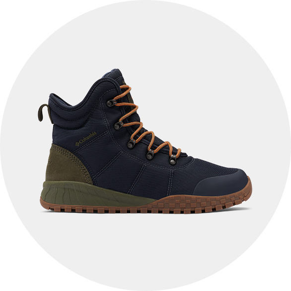 A black, tan, and green mens winter boot.