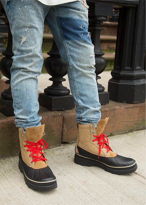 Darian Hall wearing Caribou Storm boots in an urban setting