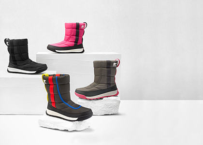 Four Kids' Whitney boots on a white background