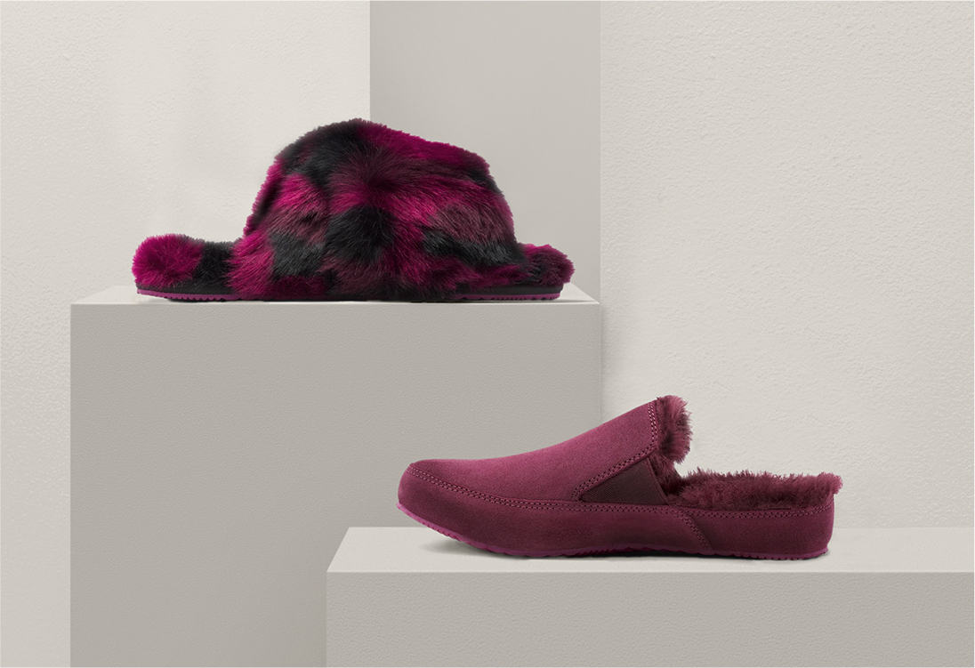 Two purple slippers on a platform