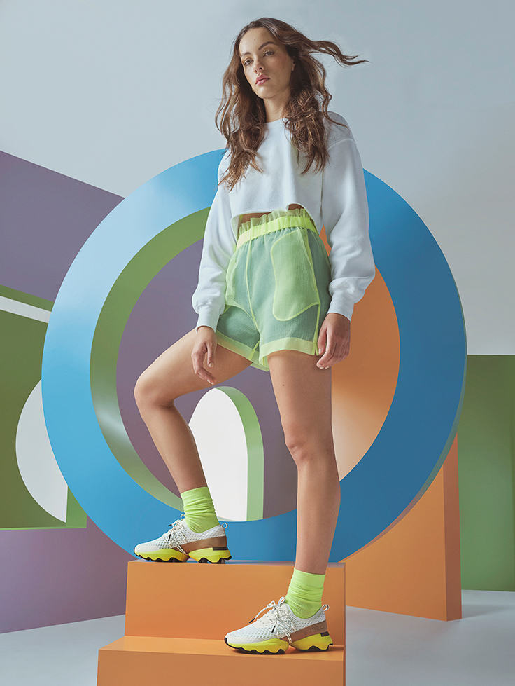 Woman wearing new Kinetic Impact sneaker posing