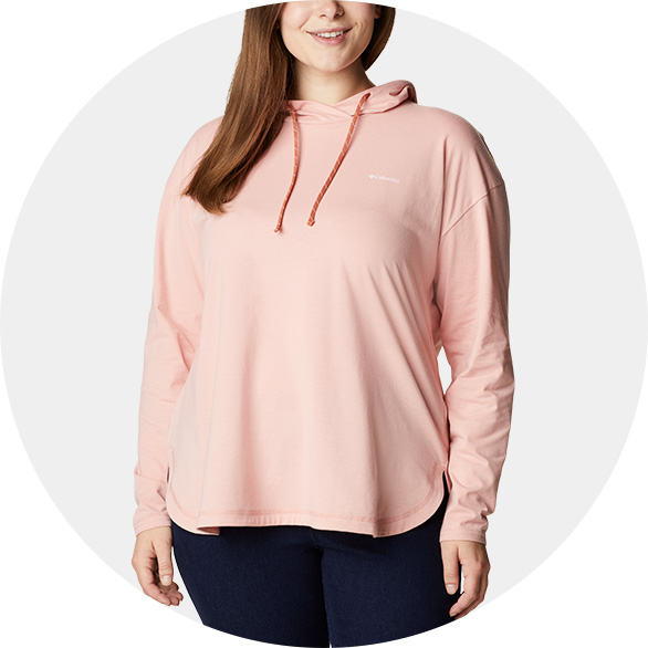 Woman in a light pink hoodie.