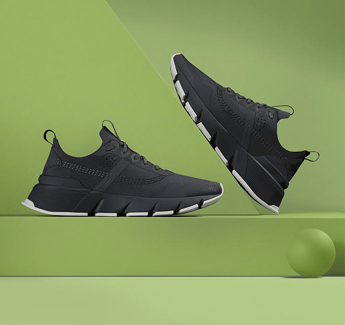 A pair of Kinetic Rush Ripstop sneakers on a green background
