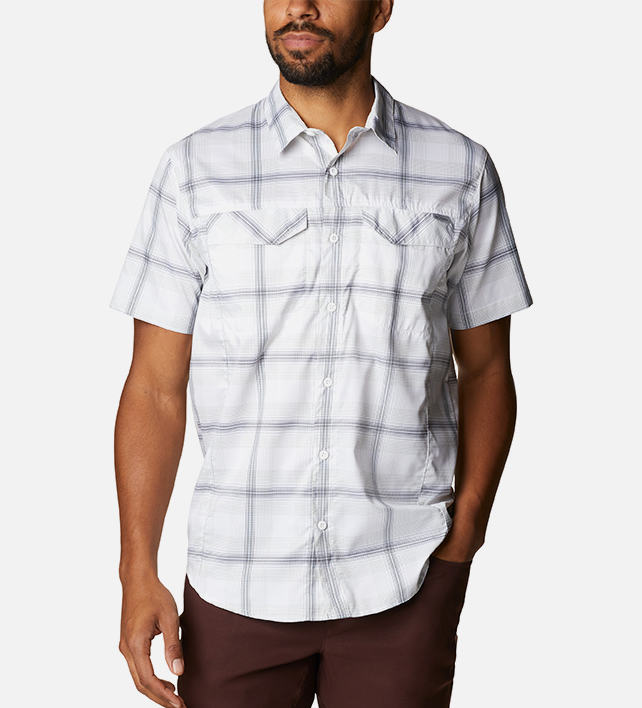 Man in a white plaid button-down shirt.