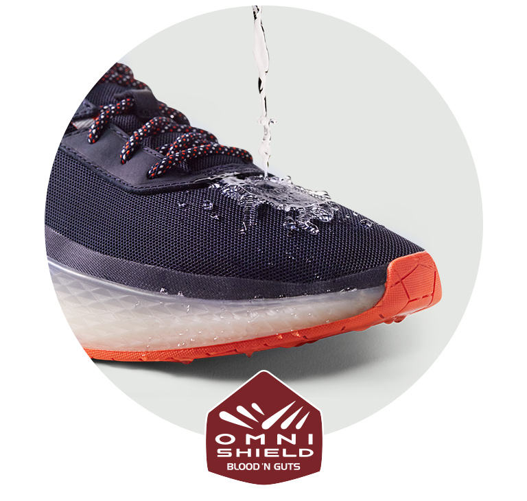 A close up of PFG shoes getting messy. Omni-Shield Blood 'N Guts technology badge below.