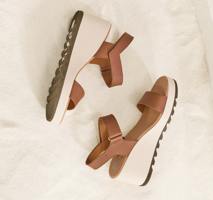 An Cameron Wedge sandals  on a beige background