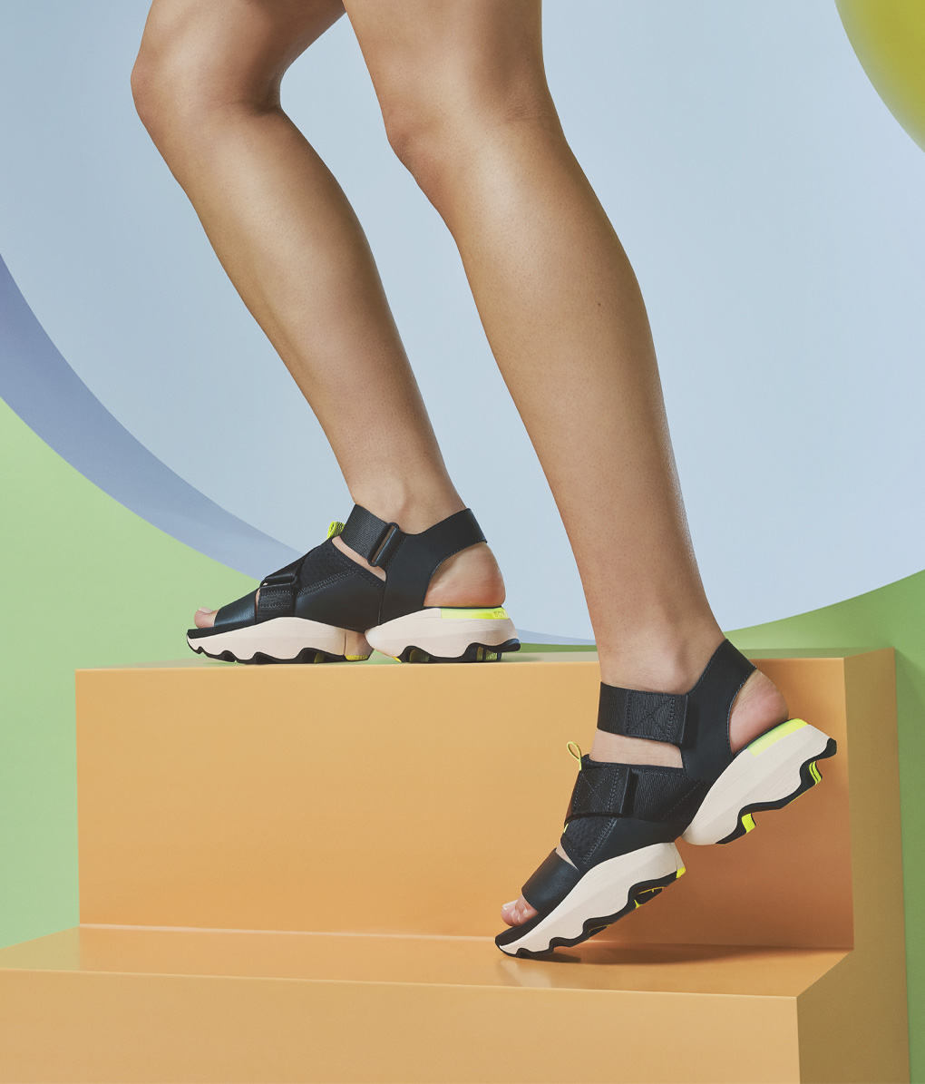 Thigh down image of a woman wearing new Kinetic Sandals