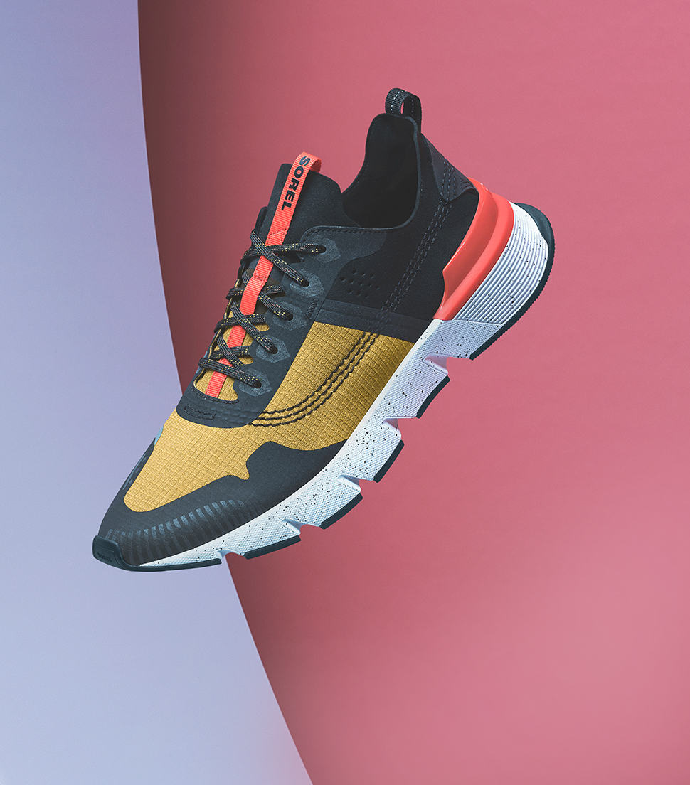 A Men's Kinetic Rushstop sneaker with a colorful background