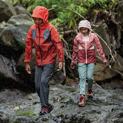 Two kids hiking in Columbia rain gear.