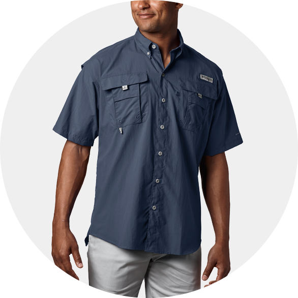 Man in a Navy PFG Bahama II short sleeve shirt