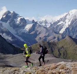 Still photo from the UTMB video Beyond Ultra. Play button links to video.