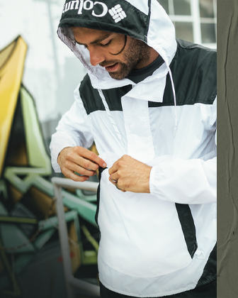 A man wearing a Challenger windbreaker