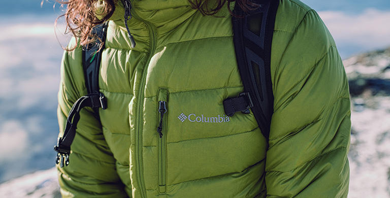 A person wearing a winter jacket made with Responsible Down.