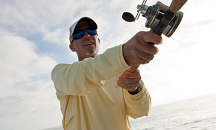 A fisherman wearing gear with Omni-Shield Release technology.