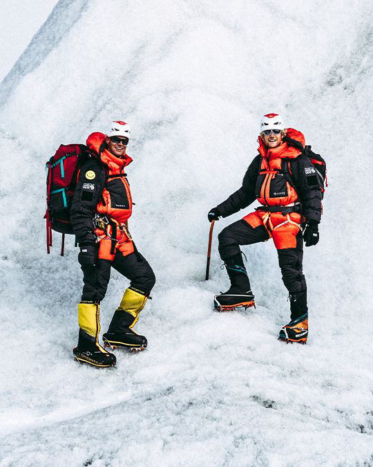 Mountain Hardwear athletes Garrett Madison and Tim Emmett, explore the glacier field near Everest Base Camp wearing the Absolute Zero Suit.