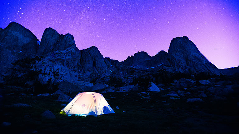View of the Mineral King Tent in the high alpine under a very starry night.