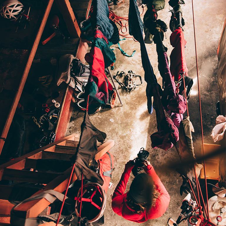 Aerial view of an ice climber and all of their gear drying in a hut