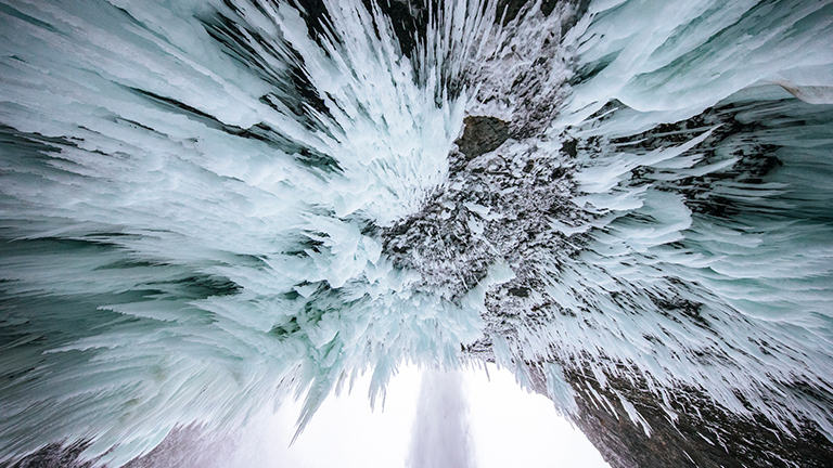 Looking up at a lot of ice in the wilderness