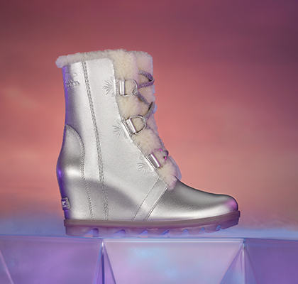 A Frozen 2 women's Joan Wedge Shearling on a pink background