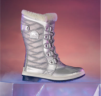A Frozen 2 women's Tofino boot on a pink background